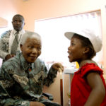 12 December 2002. Nelson Mandela visits an AIDS organisation in Khayelitsha.  (Photo: Getty Images)