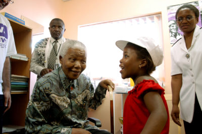 12 December 2002. Nelson Mandela visits an AIDS organisation in Khayelitsha. (Photo: Getty Images)